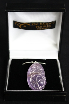 """Amethyst"" Crystal Pendant in hand-knitted silver wire – Hand-made jewellery"