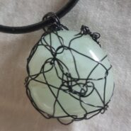 Aquamarine Crystal in hand-knitted wire on leather necklace